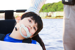 Disabled little boy in wheelchair next to father Royalty Free Stock Photography