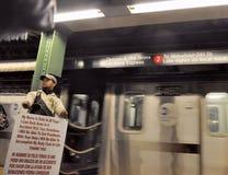 Disabled man asks for donations at platform of subway. New York, USA-November 10,2012: Disabled man asks for donations at platform of subway royalty free stock images
