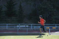 Disabled man athlete training with leg prosthesis. royalty free stock photos