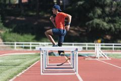 Disabled man athlete training with leg prosthesis. royalty free stock image