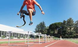 Disabled man athlete training with leg prosthesis. stock photography