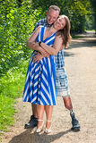 Disabled man and attractive woman in loving hug Royalty Free Stock Image