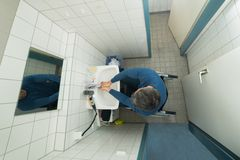 Disabled man in bathroom washing hands Royalty Free Stock Photos