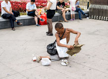 A disabled man begging in the streets of Beijing Stock Images