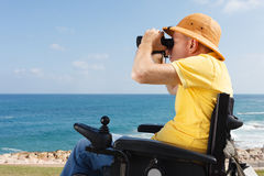 Disabled man with binocular Royalty Free Stock Photography