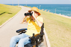 Disabled man with binocular. Royalty Free Stock Photo