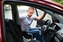 Disabled man boarding in his car Royalty Free Stock Photo