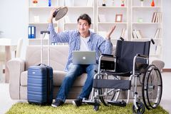 The disabled man booking travel online using laptop computer Royalty Free Stock Image