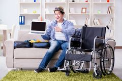 The disabled man booking travel online using laptop computer Stock Images