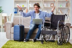 The disabled man booking travel online using laptop computer Stock Photos