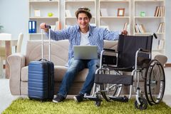 The disabled man booking travel online using laptop computer Royalty Free Stock Photos