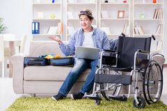 The disabled man booking travel online using laptop computer Royalty Free Stock Images
