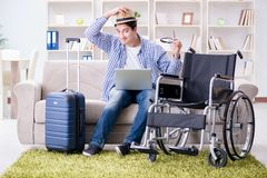 The disabled man booking travel online using laptop computer Royalty Free Stock Photo