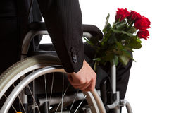 Disabled man with bouquet of flowers Stock Image