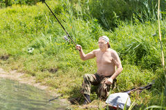 Disabled man casting his fishing rod Royalty Free Stock Images