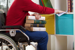 Disabled man during cleaning furniture Stock Photo