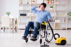 The disabled man cleaning home with vacuum cleaner Royalty Free Stock Photos