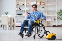 The disabled man cleaning home with vacuum cleaner Royalty Free Stock Photography