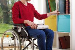 Disabled man clearing out documents Royalty Free Stock Photos