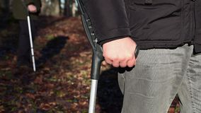 Disabled man with crutches stock footage