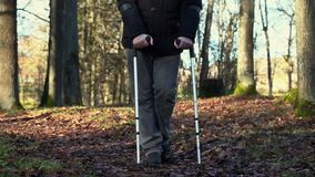 Disabled man on crutches at outdoor stock video footage