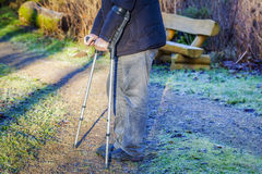 Disabled man on crutches at outdoor on the path Stock Photos
