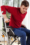 Disabled man with crutches Royalty Free Stock Image