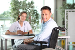 Disabled man with doctor Royalty Free Stock Photos
