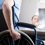 Disabled man at doctors office Stock Photography
