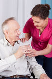 Disabled man drinking water Stock Photography