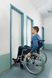 Disabled man entering in room Stock Image