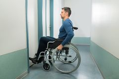Disabled man entering in room Stock Photos