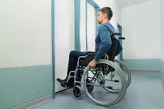 Disabled man entering in room Royalty Free Stock Images