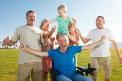 Disabled man with family. royalty free stock image