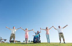 Disabled Man with family outside. Stock Photography