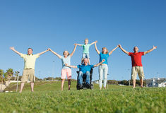 Disabled Man with family outside. Stock Image