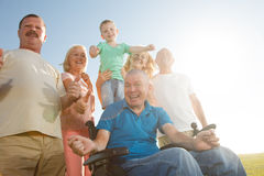 Disabled Man with family outside. Royalty Free Stock Photography