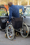 Disabled man getting in the car Royalty Free Stock Photos