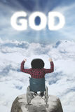 Disabled man with GOD text on sky Stock Photography