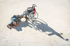 Disabled man with handicap on accident crash with wheelchair Royalty Free Stock Photography