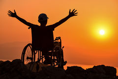 Disabled Man ,handicaps And Sunrise & Happy And Peaceful Disability Royalty Free Stock Photography