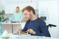 Disabled man having lunch Stock Photos