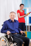 Disabled man and helpful granddaughter Stock Image