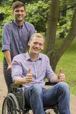 Disabled man with his brother Stock Photo