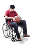 Disabled man holds basketball on wheelchair Stock Image