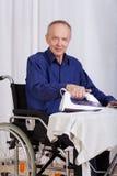 Disabled man during ironing Stock Image