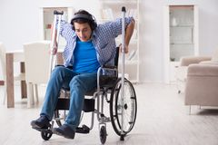 The disabled man listening to music in wheelchair. Disabled man listening to music in wheelchair Stock Photography