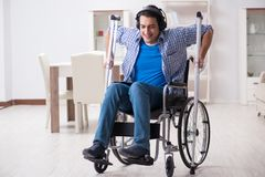 The disabled man listening to music in wheelchair. Disabled man listening to music in wheelchair Royalty Free Stock Image