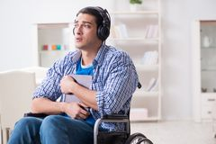 The disabled man listening to music in wheelchair. Disabled man listening to music in wheelchair Royalty Free Stock Images