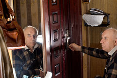 Disabled man locking a door Stock Photo